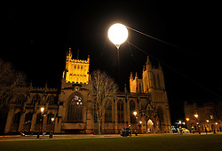 "© Licensed to London News Pictures. 14/02/2013. Bristol, UK. IBT13 International Festival of Performance.  Picture of ""Fake Moon"" by Simon Faithfull, on Bristol's College Green by Bristol Cathedral.  14 February 2013..Photo credit : Simon Chapman/LNP"