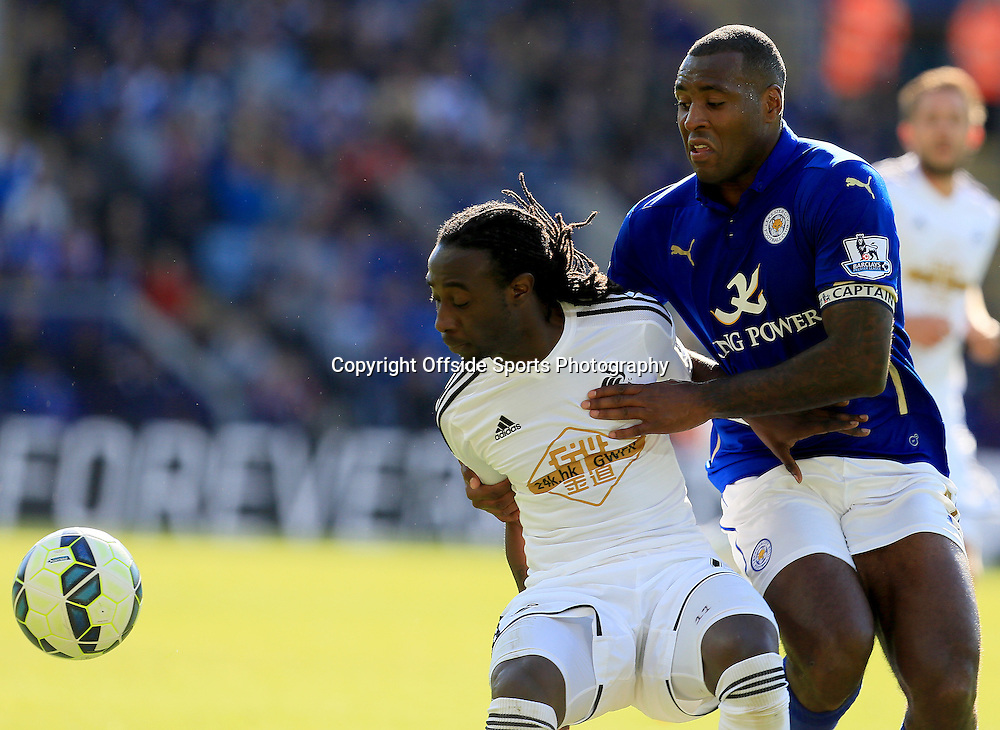 18th April 2015 - Barclays Premier League - Leicester City v Swansea - Marvin Emnes of Swansea City holds off Jeff Schlupp of Leicester City - Photo: Paul Roberts / Offside.