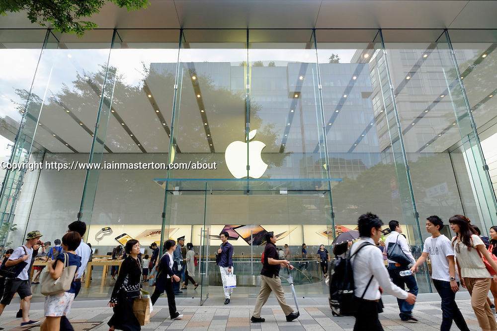 Busy shopping street and modern Apple store  in elegant Omotesando district of Tokyo Japan