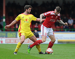 Milton Keynes Dons' Will Grigg tussles with Swindon Town's Ben Gladwin - Photo mandatory by-line: Paul Knight/JMP - Mobile: 07966 386802 - 04/04/2015 - SPORT - Football - Swindon - The County Ground - Swindon Town v Milton Keynes Dons - Sky Bet League One