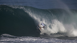 December 11, 2017 - Banzai Pipeline, HI, USA - BANZAI PIPELINE, HI - DECEMBER 11, 2017 - Josh Kerr of Australia gets hit by the wave lip in the first round of the Billabong Pipe Masters. (Credit Image: © Erich Schlegel via ZUMA Wire)