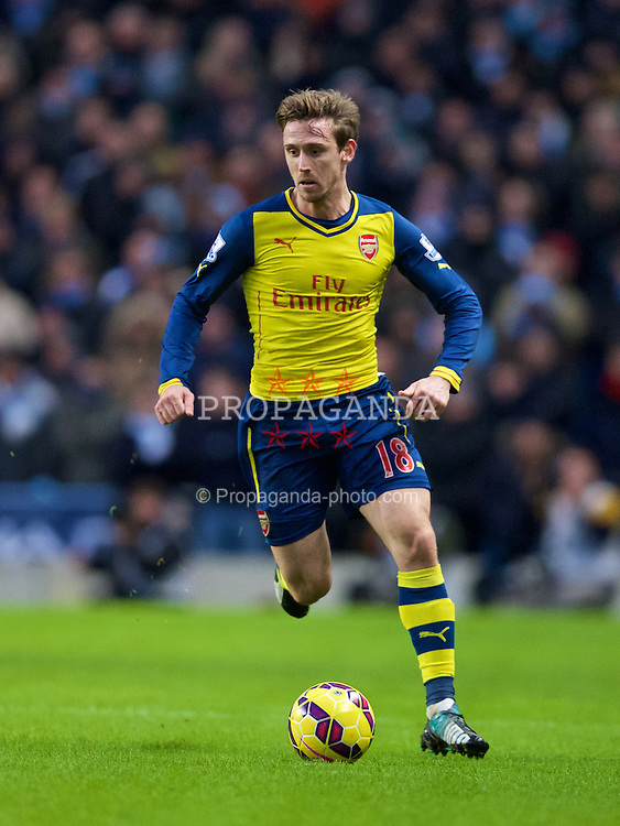 MANCHESTER, ENGLAND - Sunday, January 18, 2015: Arsenal's Nacho Monreal in action against Manchester City during the Premier League match at the City of Manchester Stadium. (Pic by David Rawcliffe/Propaganda)