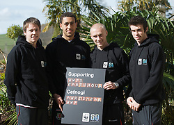 CARDIFF, WALES - Tuesday, March 24, 2009: Wales' players L-R Chris Gunter, Lewin Nyatanga, David Cotterill and Gareth Bale lend their support to WWF's Earth Hour as they take time out of training to help promote the campaign and urge all football fans to participate in this global initiative. WWF's Earth Hour will see over 1400 cities in 75 countries switch off their lights at 8.30pm this Saturday 28th March as a graphic demonstration to world leaders that people want action on climate change. For more information visit: www.wwf.org.uk/earthhourwales. (Pic by David Rawcliffe/Propaganda)