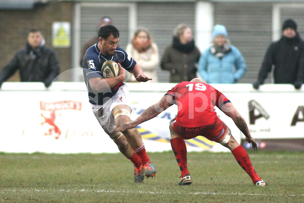 Tai Tuisamoa of London Scottish in action during the Green King IPA Championship match between London Scottish &amp; Bristol at Richmond, Greater London on 7th February 2015<br /> <br /> Photo: Ken Sparks | UK Sports Pics Ltd<br /> London Scottish v Bristol, Green King IPA Championship, 7th February 2015<br /> <br /> &copy; UK Sports Pics Ltd. FA Accredited. Football League Licence No:  FL14/15/P5700.Football Conference Licence No: PCONF 051/14 Tel +44(0)7968 045353. email ken@uksportspics.co.uk, 7 Leslie Park Road, East Croydon, Surrey CR0 6TN. Credit UK Sports Pics Ltd
