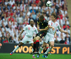 LONDON, ENGLAND - Saturday, June 2, 2012: England's Scott Parker in action against Belgium's Timmy Simons during the International Friendly match at Wembley. (Pic by David Rawcliffe/Propaganda)