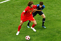 SAINT PETERSBURG, RUSSIA - JULY 10: Benjamin Pavard (R) of France national team and Marouane Fellaini of Belgium national team vie for the ball during the 2018 FIFA World Cup Russia Semi Final match between France and Belgium at Saint Petersburg Stadium on July 10, 2018 in Saint Petersburg, Russia. MB Media