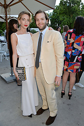 JOSEPH & SABINE GETTY at The Ralph Lauren & Vogue Wimbledon Summer Cocktail Party at The Orangery, Kensington Palace, London on 22nd June 2015.  The event is to celebrate ten years of Ralph Lauren as official outfitter to the Championships, Wimbledon.