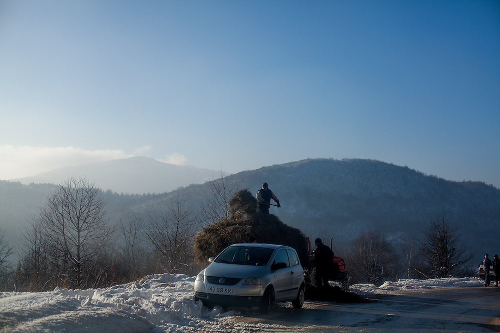 Agricultural workers on the winter road leading from the city of Hadžići up to Igman which is a mountain plateau in central Bosnia and Herzegovina. During the 1984 Winter Olympics, Igman was, along with Jahorina and Bjelašnica, the location of the competition in the alpine and Nordic sports disciplines. The family of Elvis settled in Hadžići  after the war ended in Bosnia. Hadžići is a town and a municipality located about 20 km south west of Sarajevo city but within the Sarajevo Canton of Bosnia and Herzegovina. According to the census of 2013, Hadžići municipality has a population of 23,891 residents.