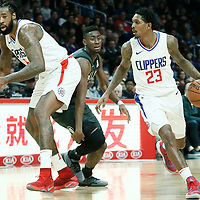 04 March 2018: LA Clippers guard Lou Williams (23) drives past Brooklyn Nets guard Caris LeVert (22) on a screen set by LA Clippers center DeAndre Jordan (6) during the LA Clippers 123-120 victory over the Brooklyn Nets, at the Staples Center, Los Angeles, California, USA.
