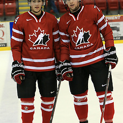WELLINGTON, - Dec 11, 2015 -  Exhibition Game 2- Canada East vs USA at the 2015 World Junior A Challenge at the Wellington District Community Centre, ON.<br /> Ben Sokay #24 of Team Canada East ,Luc Brown #7 of Team Canada East<br />  (Photo: Ed McPherson/ OJHL Images)