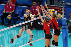 Japan Yukiko Ebata spikes against Belgium's block