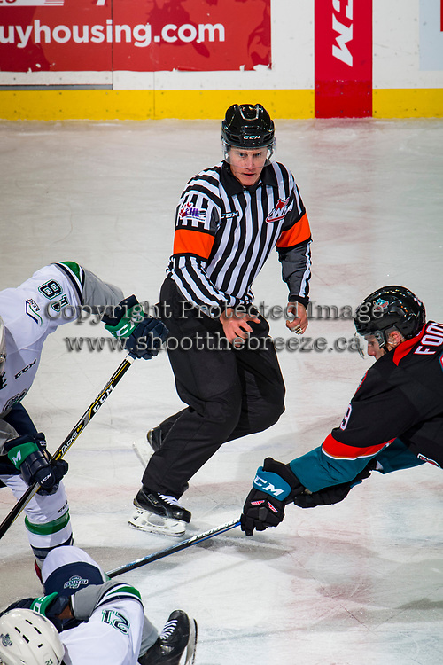KELOWNA, CANADA - OCTOBER 10:  Referee Ward Pateman skates at centre ice after dropping the puck between the Kelowna Rockets and the Seattle Thunderbirds on October 10, 2018 at Prospera Place in Kelowna, British Columbia, Canada.  (Photo by Marissa Baecker/Shoot the Breeze)  *** Local Caption ***
