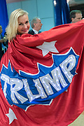 A GOP delegate wears a Trump superhero cape and costume during the second day of the Republican National Convention July 19, 2016 in Cleveland, Ohio. Earlier in the day the delegates formally nominated Donald J. Trump for president.