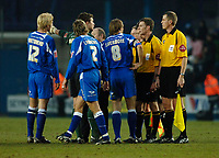 Photo: Daniel Hambury.<br />Millwall v Sheffield Wednesday. Coca Cola Championship. 04/02/2006.<br />Millwall's players surround referee Steve Tanner (2nd right) at the final whistle.