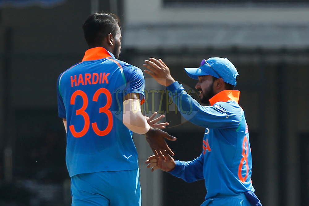 Hardik Pandya of India and Kedar Jadhav of India celebrates the wicket of David Warner of Australia during the 3rd One Day International between India and Australia held at the Holkar Stadium in Indore on the 24th  September 2017<br /> <br /> Photo by Deepak Malik / BCCI / SPORTZPICS