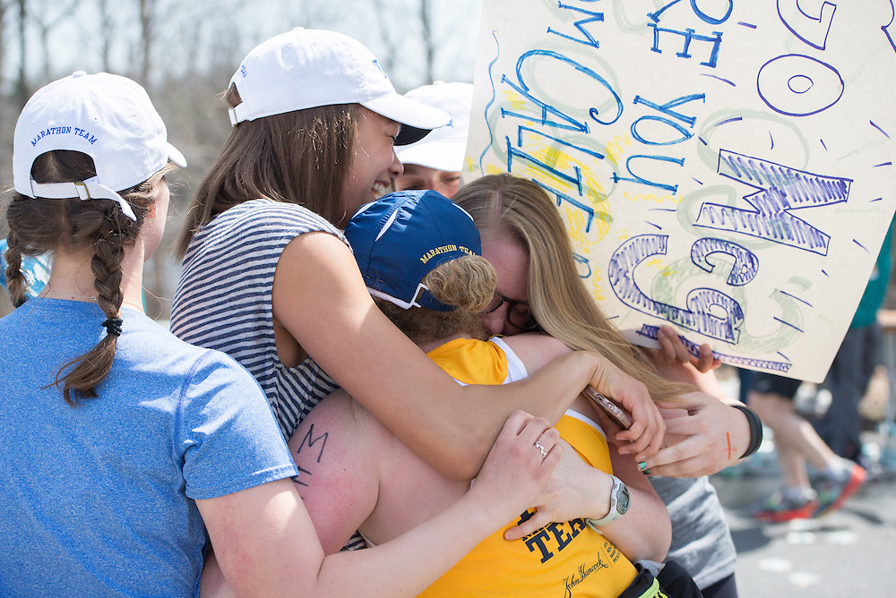 4/18/16 – Natick, MA – Meg Nichols (LA'16) is embraced by friends at Mile 9 of the 2016 Boston Marathon in Natick, MA on April 18, 2016. (Sofie Hecht / The Tufts Daily)