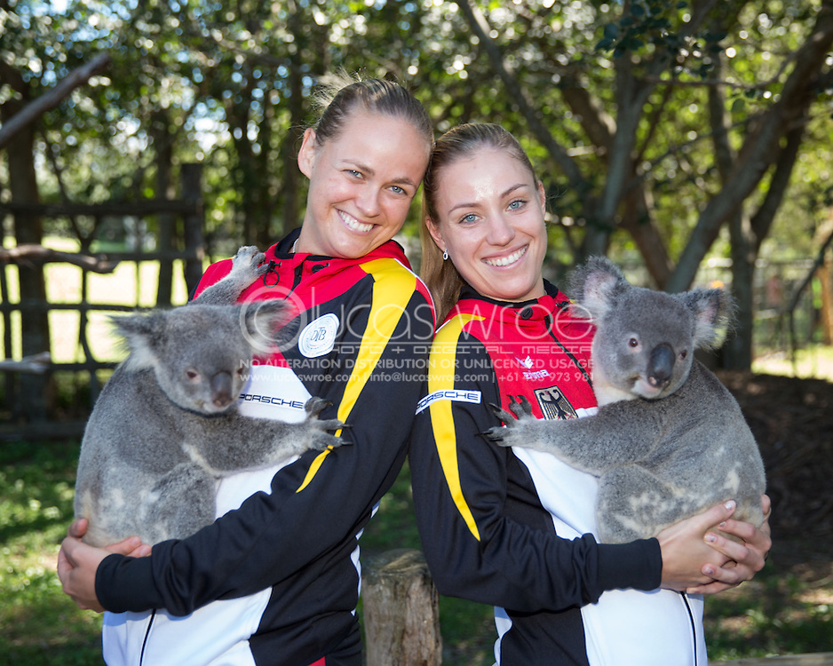 Anna-Lena Groenefeld (GER) and Angelique Kerber (GER), April 18, 2014 - TENNIS : Fed Cup, Semi-Final, Australia v Germany. Lone Pine Koala Sanctuary, Brisbane, Queensland, Australia. Credit: Lucas Wroe