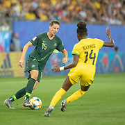 GRENOBLE, FRANCE June 18.  Emily Gielnik #15 of Australia define by Deneisha Blackwood #14 of Jamaica during the Jamaica V Australia, Group C match at the FIFA Women's World Cup at Stade des Alpes on June 18th 2019 in Grenoble, France. (Photo by Tim Clayton/Corbis via Getty Images)