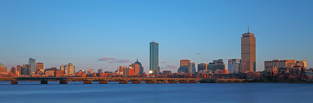 Stunning Boston skyline panorama photography from New England based skyline photographer Juergen Roth. This Boston panorama photography image shows familiar Boston landmarks such as the Prudential Center and 200 Clarendon office building formerly known as John Hancock Tower in the Back Bay, the Massachusetts State House and the newly constructed Millennium Tower in Beacon Hill as seen from Cambridge, MA. Memorial Drive one of Boston best photo locations. <br />