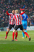 Lincoln City Forward Matt Green celebrates with Lincoln City Midfielder Elliott Whitehouse as he scores a goal to make it 2-0 during the EFL Sky Bet League 2 match between Lincoln City and Grimsby Town FC at Sincil Bank, Lincoln, United Kingdom on 17 March 2018. Picture by Craig Zadoroznyj.
