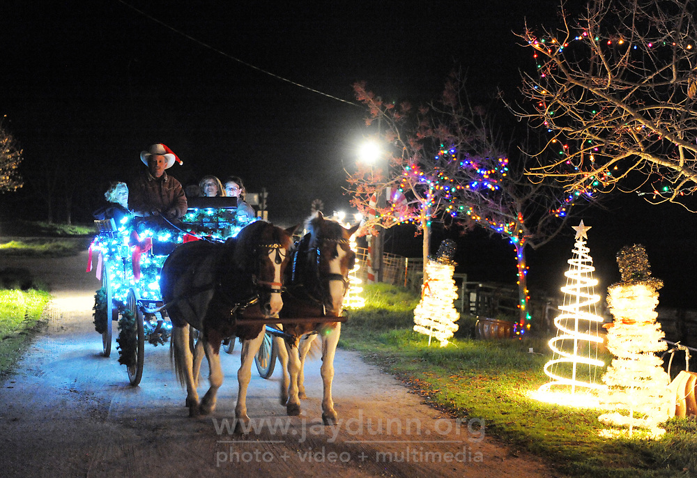 Michael Mastroianni leads a Christmas carriage-ride on Wednesday evening in Prunedale.