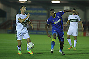 AFC Wimbledon striker Tyrone Barnett (23) and Plymouth Argyle defender & captain Gary Miller (2) during the EFL Trophy match between AFC Wimbledon and Plymouth Argyle at the Cherry Red Records Stadium, Kingston, England on 4 October 2016. Photo by Stuart Butcher.