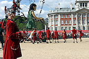 The Little Girl of the play being moved towards her chair, while a woman in the foreground is controlling part of the elephant, central London, on Friday, May 5, 2006. The Sultan's Elephant show, for the first time in London is a magical, and unique in the world, theatrical show across the streets, performed by an international French company - Royal De Luxe - specialised in constructing and giving 'life' to enormous mechanical puppets. The Sultan's Elephant is the story of a Sultan dreaming of a little girl that travels through time. **ITALY OUT**