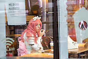 UNITED KINGDOM, London: 23 October 2015. <br /> Comic Con Feature.<br /> Cosplay fan Emma Scott 39 dressed as a sweet Lolita has a coffee in a Starbucks outside of the Convention.<br /> Photo: Rick Findler / Story Picture Agency