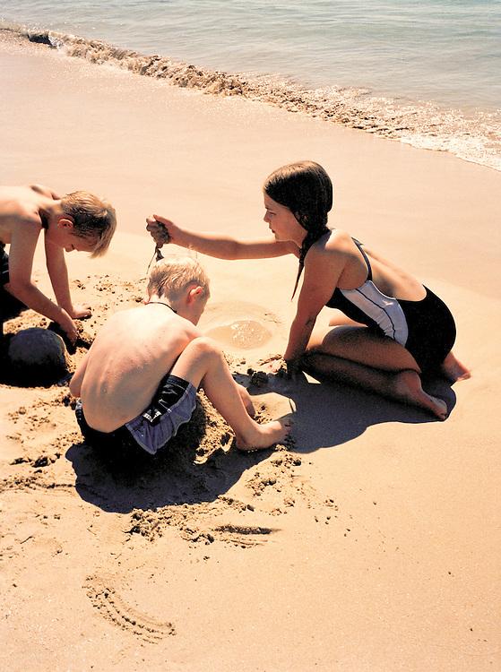 European children play on the beach
