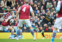 BIRMINGHAM, ENGLAND - Easter Sunday, March 31, 2013: Liverpool's Glen Johnson sees his shot blocked by the arm of Aston Villa's Nathan Baker during the Premiership match at Villa Park. (Pic by David Rawcliffe/Propaganda)