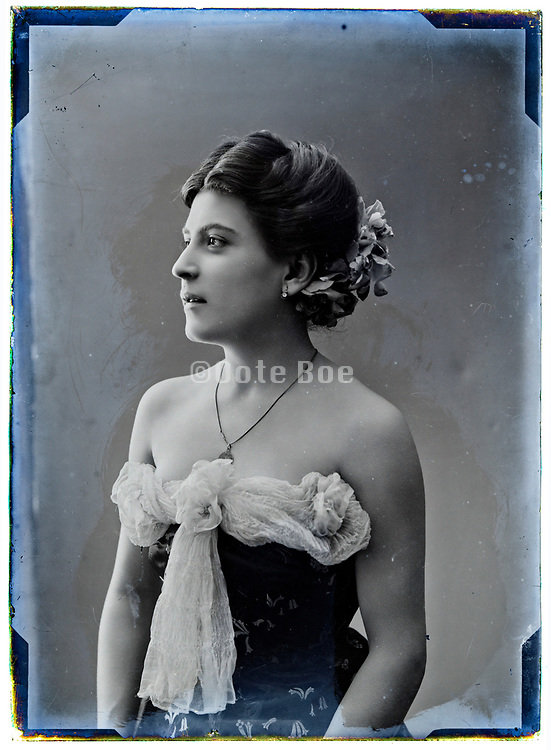 elegant daylight studio portrait of woman on a deteriorating glass plate France 1900s