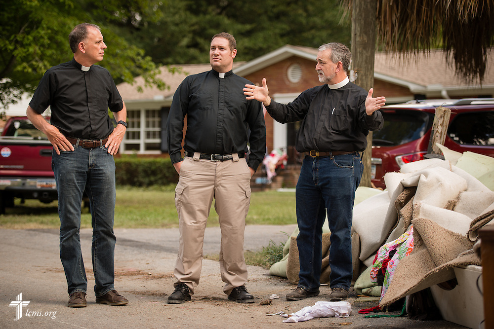 The Rev. Christopher Burger (right), pastor of Holy Trinity Lutheran Church in Columbia, S.C., surveys damage from recent flooding with the Rev. Michael Meyer, manager of LCMS Disaster Response (center), and the the Rev. Dr. John R. Denninger, LCMS Southeastern District president,  in Columbia on Thursday, Oct. 8, 2015. LCMS Communications/Erik M. Lunsford