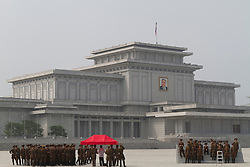 FILE PICTURE © Licensed to London News Pictures. 11/08/2011. Pyongyang, North Korea. North Korean soldiers wait to have a photograph taken outside the Kumsusan Memorial Palace in Pyongyang where Kim Jong-Ils body is currently in state, in preperation for his funeral. The memorial palace has held Jong-Il's father (Kim Il-Sung) in state since his death in 1994. . Photo credit : James Gourley/LNP