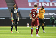 Players from both teams hold a minutes silence in memory of those who have died from Covid19 during the Premier League match at the London Stadium, London. Picture date: 20th June 2020. Picture credit should read: David Klein/Sportimage