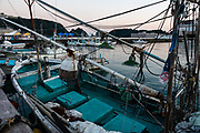 Boats in Nachikatsuura harbor at sunset, Kii Peninsula, Wakayama Prefecture, Japan.