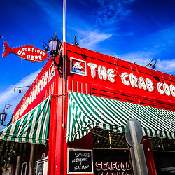 "Photo of The Crab Cooker restaurant in Newport Beach California.  The Crab Cooker is a very popular local seafood restaurant known for its bright red exterior and fish sign that says ""Don't Look Up Here"". The Crab Cooker is located at 2200 Newport Blvd., Newport Beach CA 92663"