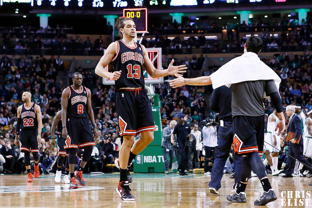 18 January 2013: Chicago Bulls center Joakim Noah (13) is congratulated by Chicago Bulls shooting guard Kirk Hinrich (12) during the Chicago Bulls 100-99 overtime victory over the Boston Celtics at the TD Garden, Boston, Massachusetts, USA.