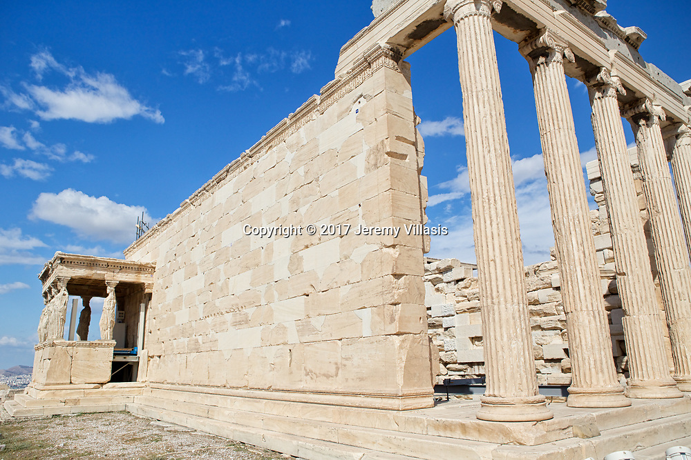 Named after the demi-god Erechtheus, the mythical Athenian king, the Erechtheion was constructed between 421-406 BC, to house the ancient wooden cult statue of Athena.<br />