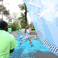 Runners of the Color Vibe 5K Run gets covered in colors at various stages throughout the race.