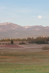 """Full Moon Over Prosser 2"" - Photograph of a full moon rising over the mountains at a very low Prosser Reservoir near Truckee, California."