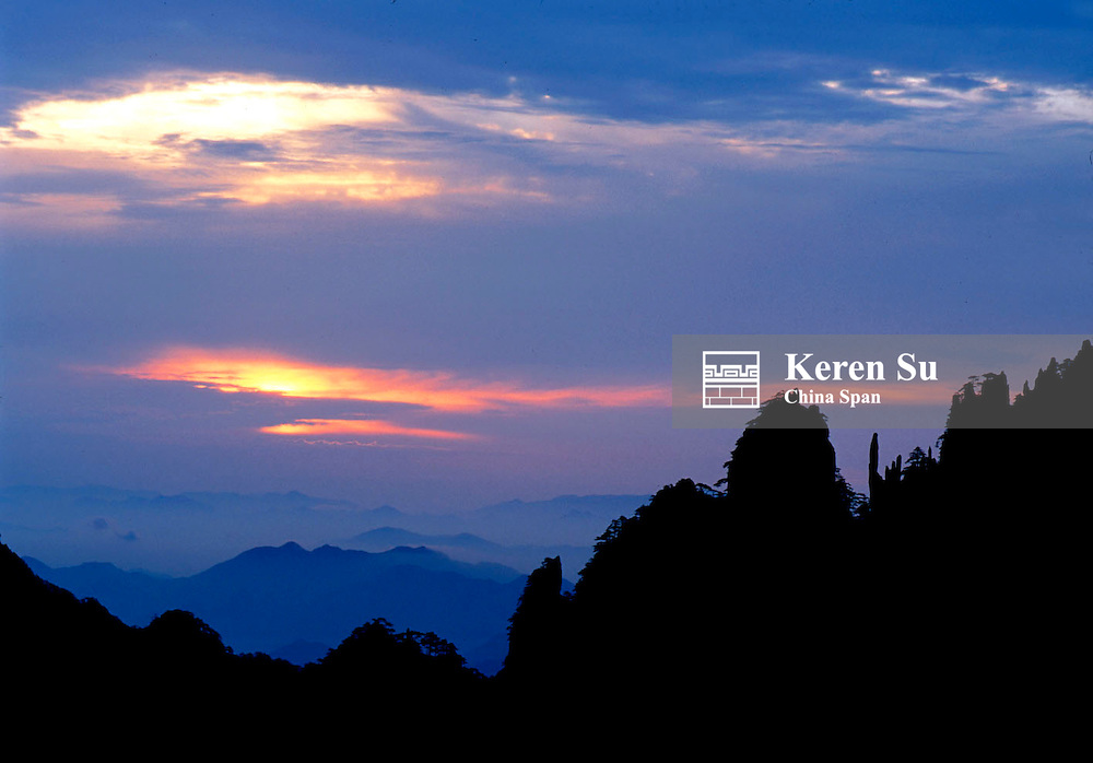 Silhouette of mountain peaks at sunrise, Mt. Huangshan (Yellow Mountain), Anhui Province, China