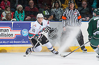 KELOWNA, CANADA - DECEMBER 30: Nick Merkley #10 of Kelowna Rockets stops on the ice to pass the puck against the Everett Silvertips on December 30, 2015 at Prospera Place in Kelowna, British Columbia, Canada.  (Photo by Marissa Baecker/Shoot the Breeze)  *** Local Caption *** Nick Merkley;
