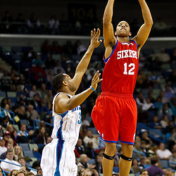 January 3, 2011; New Orleans, LA, USA; Philadelphia 76ers shooting guard Evan Turner (12) shoots a buzzer beater over New Orleans Hornets shooting guard Willie Green (33) at the end of the first quarter at the New Orleans Arena.   Mandatory Credit: Derick E. Hingle