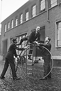 "A 70 year old 'Penny  Farthing' was presented by the Irish Raleigh Cycle Company to the Pioneer Club for use in their pantomime ""Red Riding Hood"" at the Francis Xavier Hall, Dublin. Mr. John Brierton, who will ride the bicycle on the stage, tries out his mount for the first time.  Helping him are Mr. Harry Doherty, Sales Manager, Irish Raleigh Cycle Company, and Mr. William Rocke, Publicity Officer, Red Riding Hood Pantomime..17.12.1962"