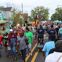 Crowds make their way up Main Street Friday evening.