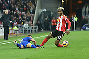 Didier Ndong (17) Sunderland AFC midfielder takes ball from Leicester City's midfielder Marc Albrighton (11) during the Premier League match between Sunderland and Leicester City at the Stadium Of Light, Sunderland, England on 3 December 2016. Photo by Ian Lyall.