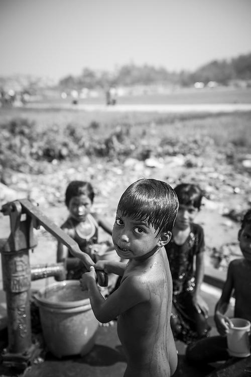 Rohingya girl pumping water at Jamtoli Refugee Camp in Bangladesh (October 26, 2017)