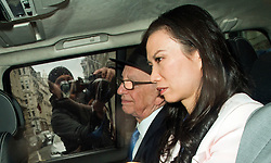© London News Pictures. 26/04/2012. London, UK. A photographer taking a picture of Rupert Murdoch (centre) as he is driven from The High Court in London with his wife Wendy Deng Murdoch on April 26, 2012 after giving evidence to the Leveson inquiry.  Photo credit : Ben Cawthra /LNP