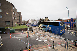 © Licensed to London News Pictures. 27/11/2016. London, UK. A French tourist coach sits stranded after it fell into a sinkhole in Lewisham. Lee High Road has been closed off and police declared a 'major incident' after the coach with 100 passengers on board fell into a sinkhole caused by a burst water mains, flooding a long stretch of the road including many local businesses. . Photo credit: Rob Pinney/LNP