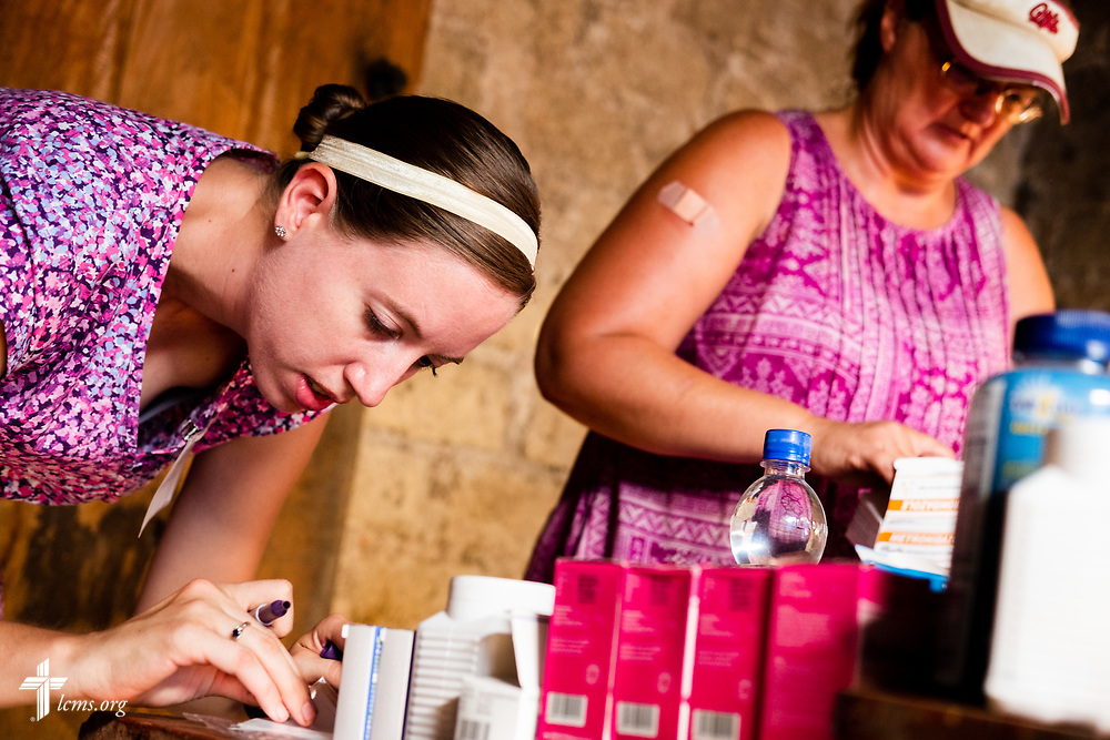 LCMS Missionaries Molly Christensen and Angie Thompson fill prescriptions in the pharmacy on the second day of the LCMS Mercy Medical Team on Tuesday, May 8, 2018, in the Yardu village outside Koidu, Sierra Leone, West Africa. LCMS Communications/Erik M. Lunsford